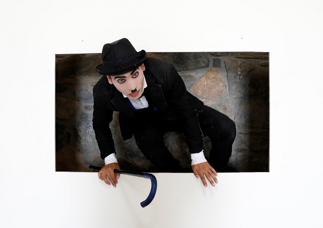 Afghanistan's Charlie Chaplin, Karim Asir, 25, exercises during his rehearsals. PHOTO: REUTERS