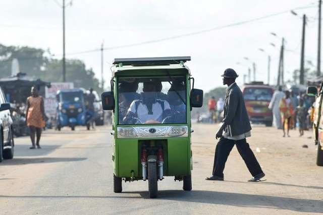 local politicians are putting great faith in chinese made tricycle taxis with rechargable solar energy panels which have been plying routes in jacqueville a coastal town outside abidjan photo afp