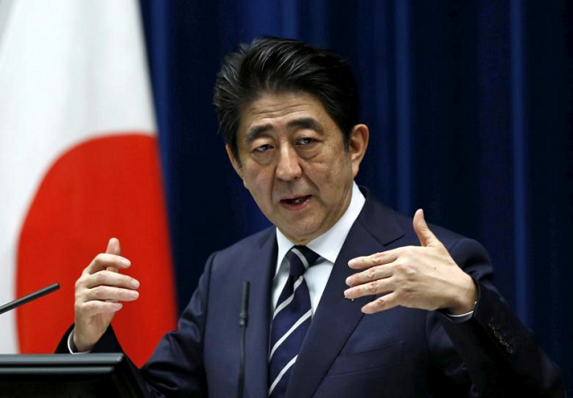 japan pm abe open to summit with north korea s kim