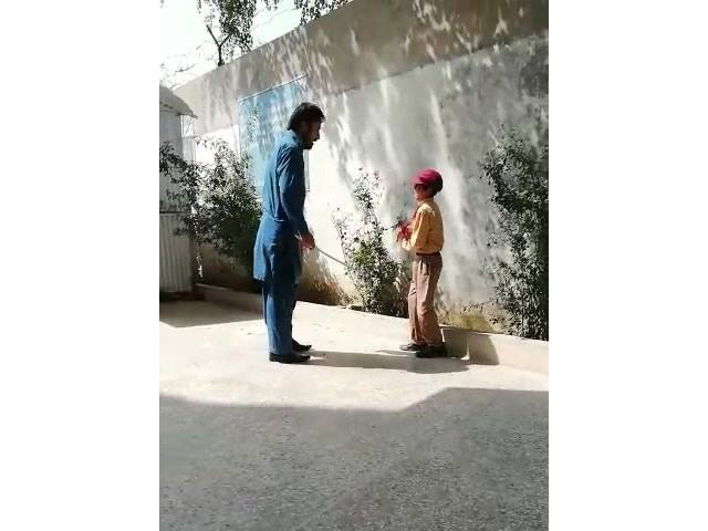 in the footage the academician is seen beating the helpless minor child repeatedly with a stick photo video screen grab