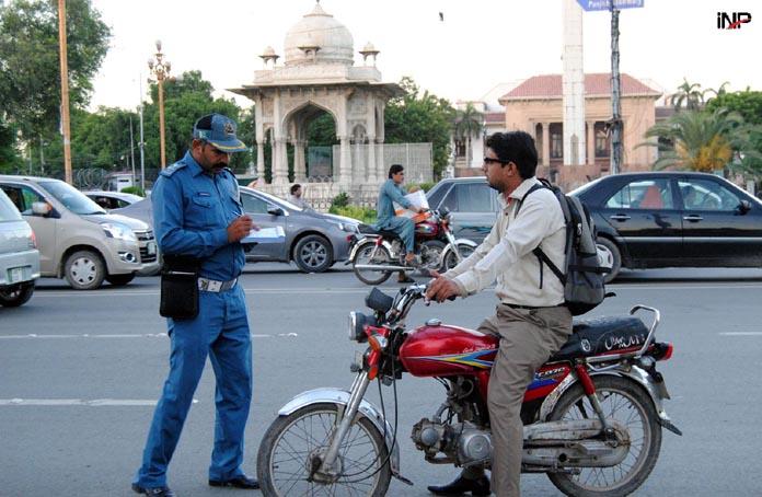 58 000 bikers challaned helmet prices surge in lahore