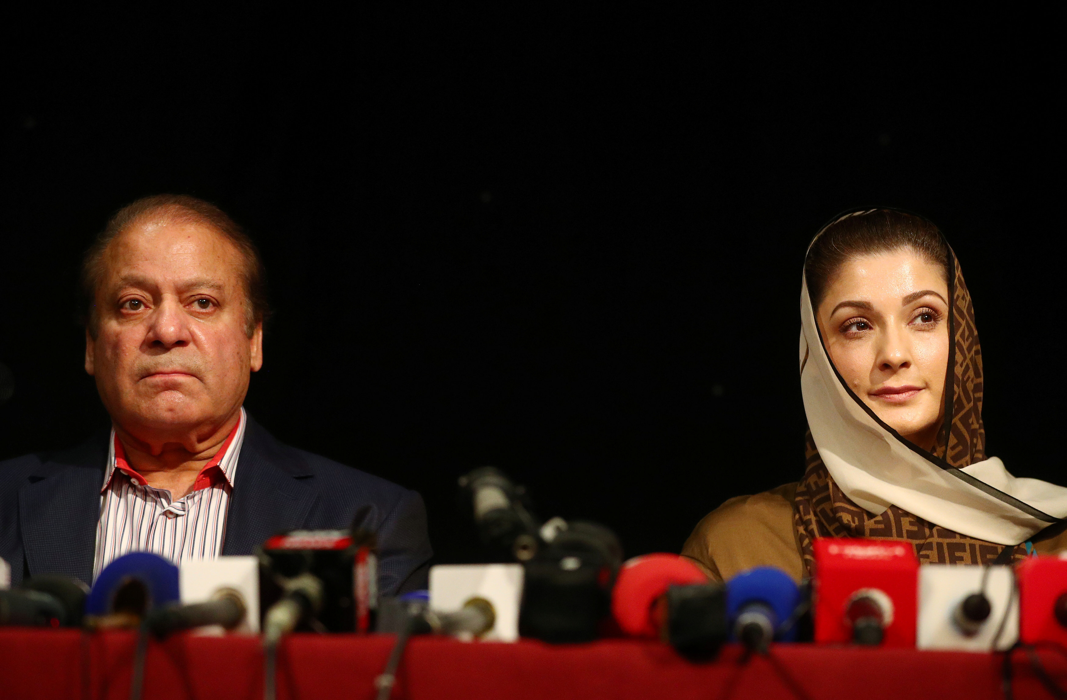 Filed photo of Nawaz and Maryam holding a press conference in London, UK. PHOTO: AFP