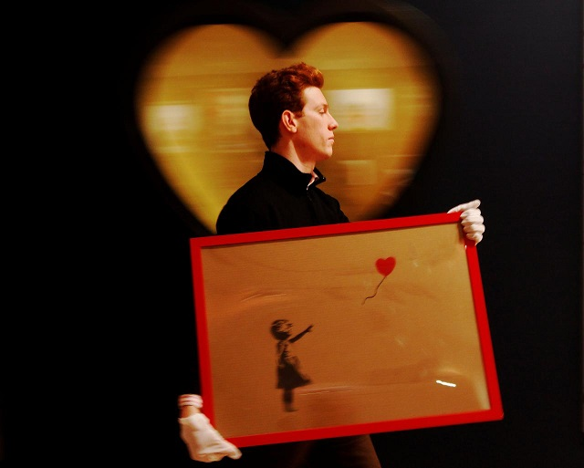banksy painting self destructs seconds after auction