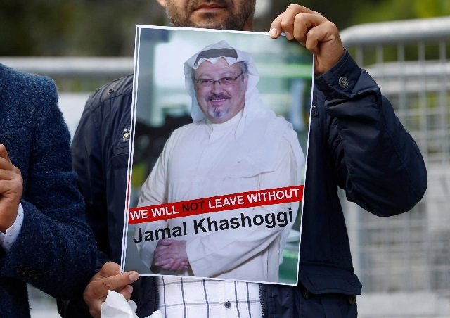 A demonstrator holds picture of Saudi journalist Jamal Khashoggi during a protest in front of Saudi Arabia's consulate in Istanbul, Turkey. PHOTO REUTERS