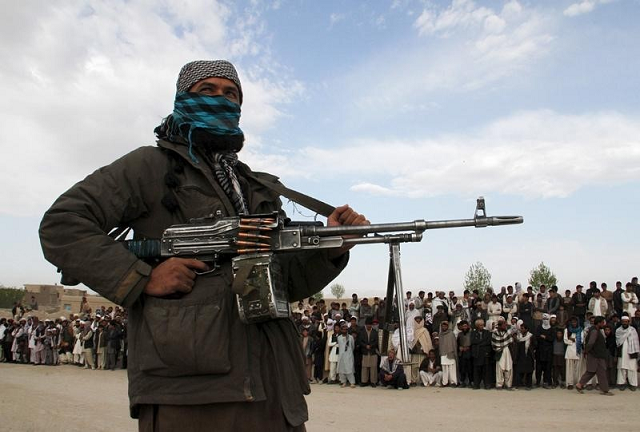 taliban kill 10 cops set fire to govt building in central afghanistan