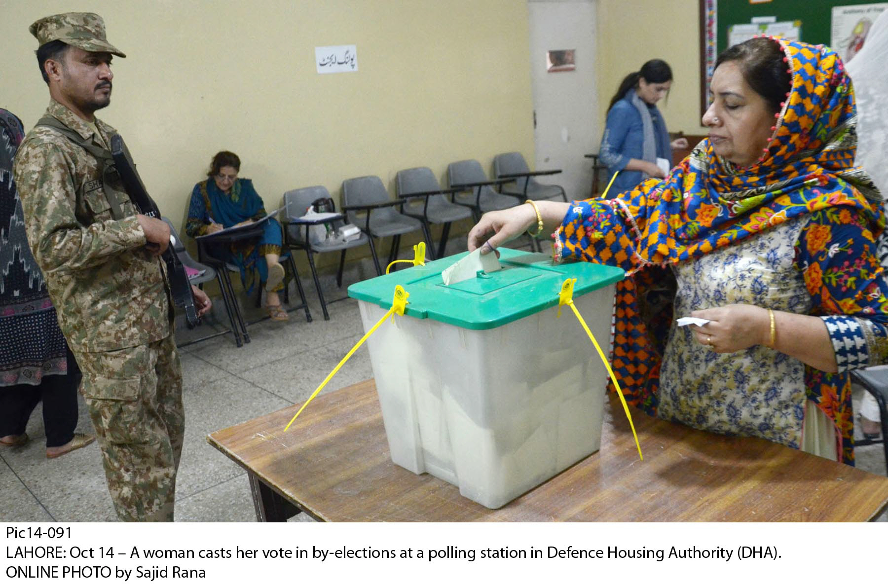 A woman casts vote during by-polls. PHOTO: ONLINE