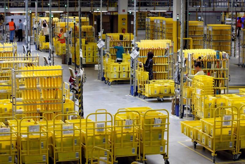 workers collect items at amazon 039 s logistics centre in graben near augsburg december 16 2013 photo reuters