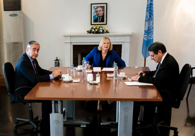 Cypriot President Nicos Anastasiades (R) and Turkish Cypriot leader Mustafa Akinci have agreed to open the first new crossing points in eight years across the island's divide at their first formal meeting since a peace conference collapsed last year. PHOTO AFP