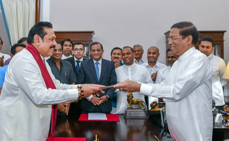 former sri lankan president mahinda rajapakse left is sworn is as prime minister by president maithripala sirisena in colombo after incumbent premier ranil wickremesinghe was sacked photo afp