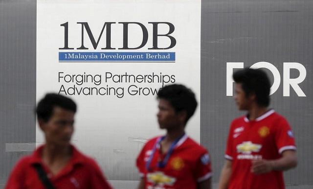 us charges financier former goldman bankers for 1mdb