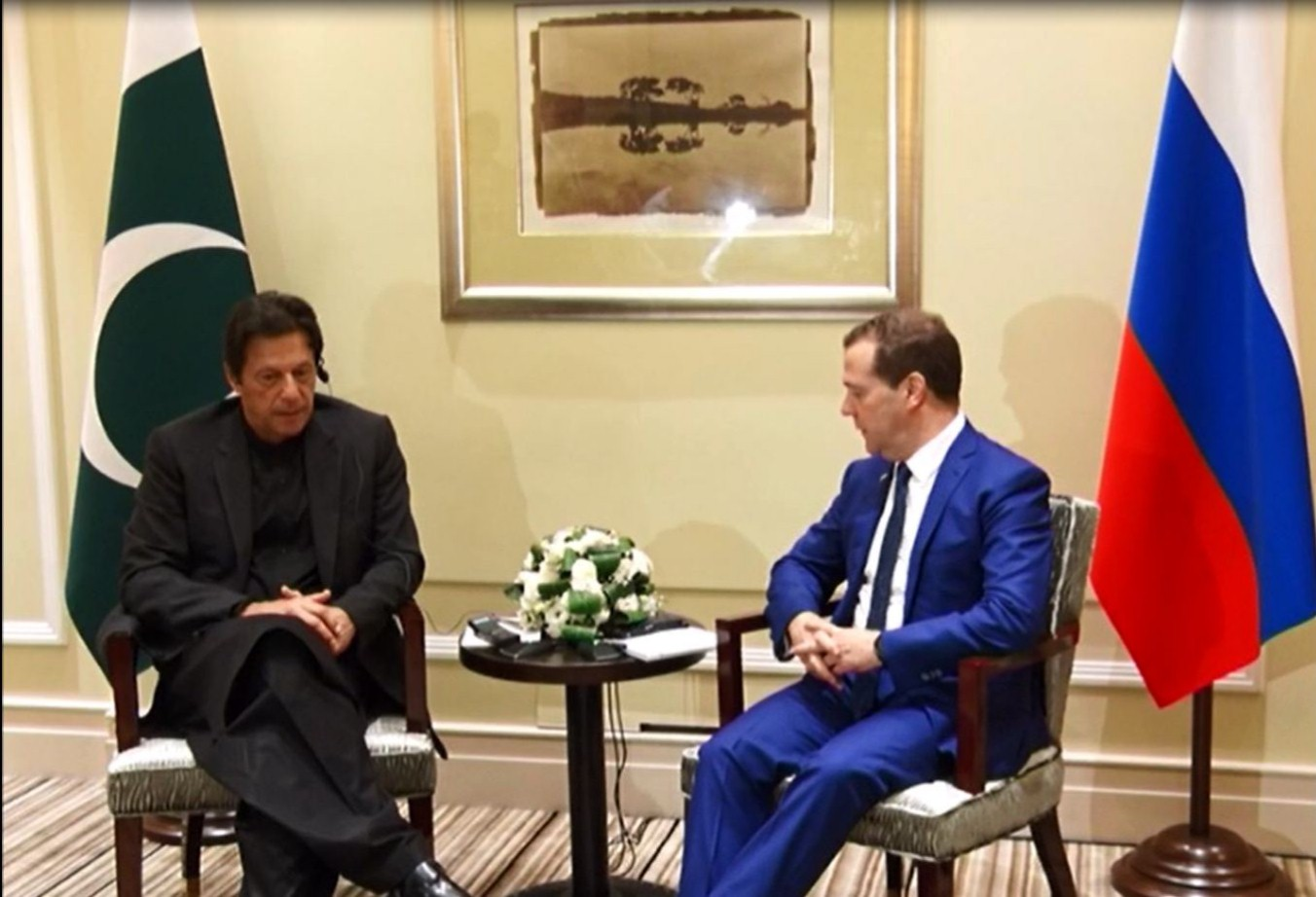 PM Imran with his Russian counterpart in Shanghai. PHOTO: RADIO PAKISTAN