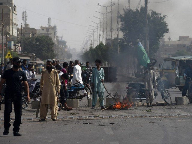 TLP supporters on a blocked street during protests. PHOTO:AFP