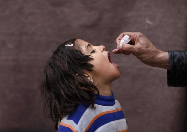 A child receives polio vaccination drops. PHOTO: REUTERS