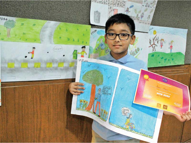 students engaged in drawing themselves as heroes solving local problems the objective of the competition was to facilitate underprivileged students to use art as a medium of expression photos athar khan express