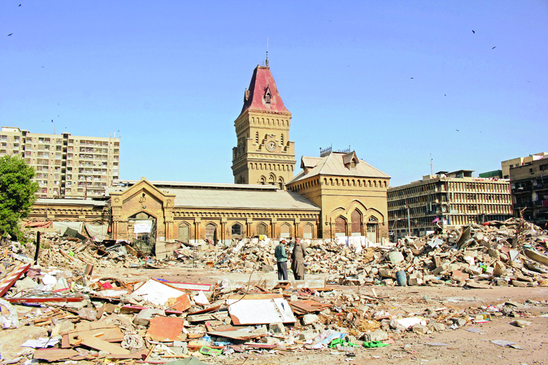 The historic structure of the Empress Market stands while surrounding illegal encroachments were razed to the ground in the operation on Sunday. Photo: Athar Khan/express