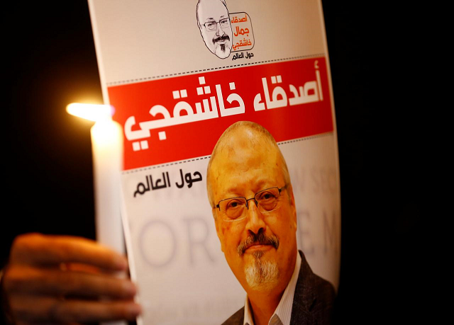 A demonstrator holds a poster with a picture of Saudi journalist Jamal Khashoggi outside the Saudi Arabia consulate in Istanbul, Turkey October 25, 2018. PHOTO: REUTERS/FILE