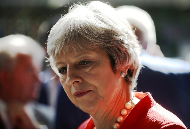 british pm fights rebellion over brexit deal