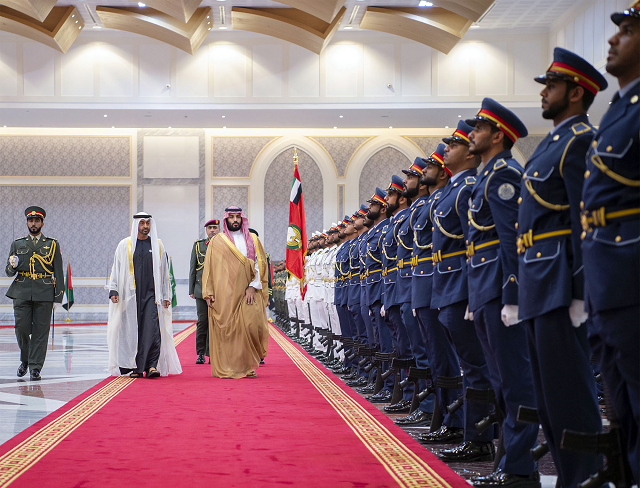 A handout picture provided by the Saudi Royal Palace on November 22, 2018, shows Saudi Crown Prince Mohammed bin Salman (C-L) meeting with Abu Dhabi's Crown Prince and Deputy Supreme Commander of the UAE Armed Forces, Sheikh Mohamed bin Zayed Al-Nahyan (C-R), upon the former's arrival in Abu Dhabi. PHOTO: AFP