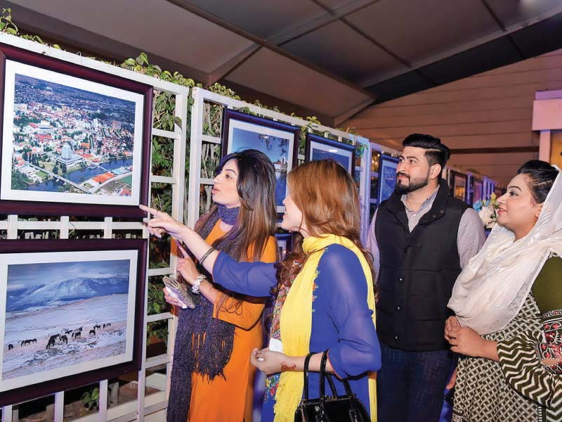 Visitors look at pictures displayed on the occasion of the National day of Bosnia in the capital. PHOTO: DNA