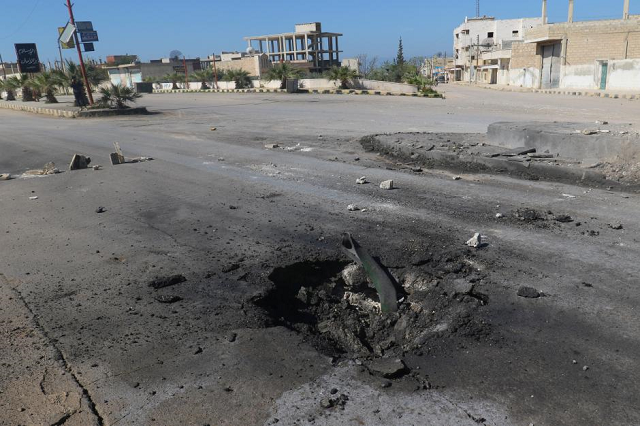 A crater is seen at the site of an airstrike, after what rescue workers described as a suspected gas attack in the town of Khan Sheikhoun in militant-held Idlib, Syria. PHOTO: REUTERS