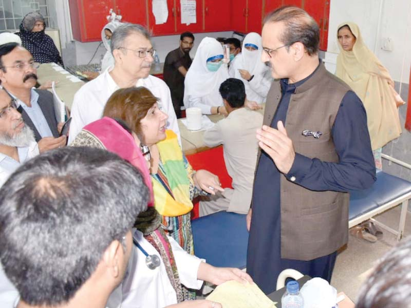 Federal Health Minister Aamer Mehmood Kiani listens to the problems of doctors during is visit to the Polyclinic on Saturday. PHOTO: WASEEM NAZIR/EXPRESS