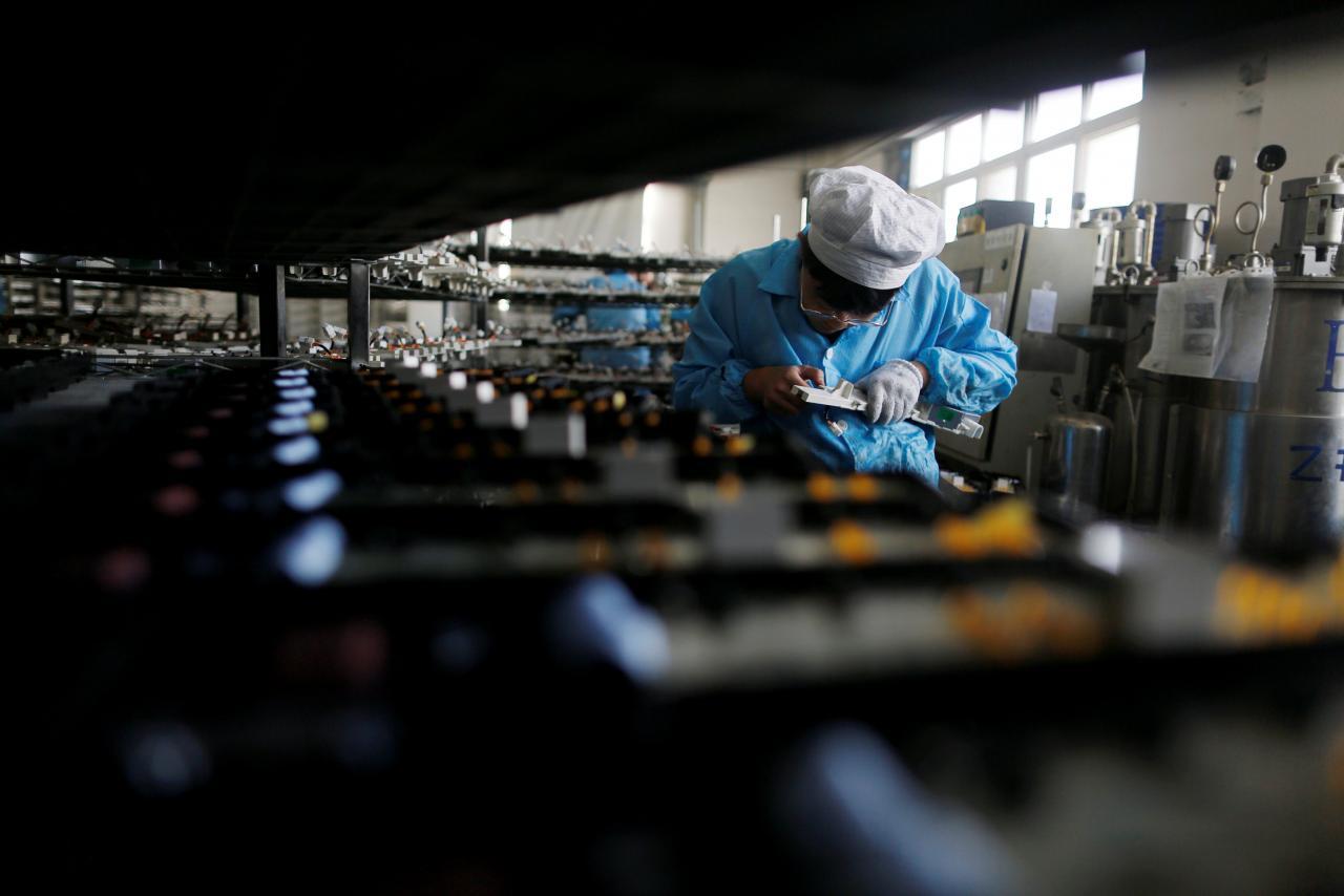 A labourer works inside an electronics factory. PHOTO: REUTERS