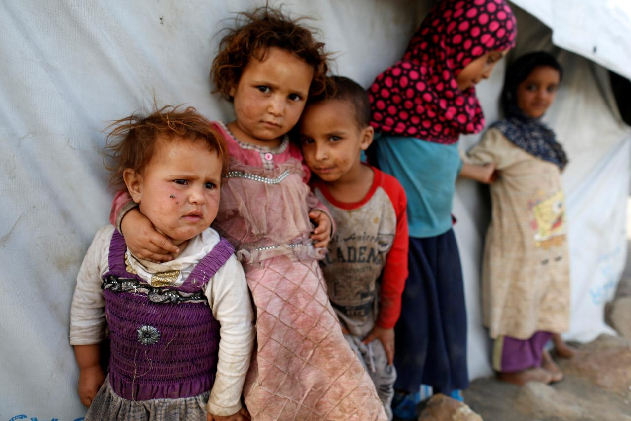 Children stand next to a tent at a camp for people displaced by the war near Sanaa, Yemen April 24, 2017. PHOTO: REUTERS