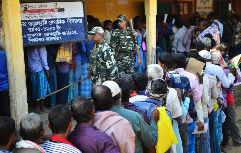 people stand in line to check their names on the first draft of the national register of citizens in assam in january photo afp