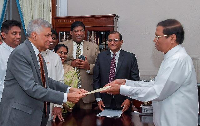 sri lanka reinstates ousted prime minister ending power struggle