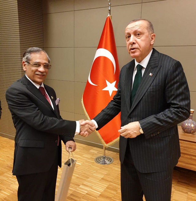 Chief Justice Mian Saqib Nasir shaking hands with Turkish President Tayyib Erdogan in Konya on December 18, 2019. PHOTO: APP