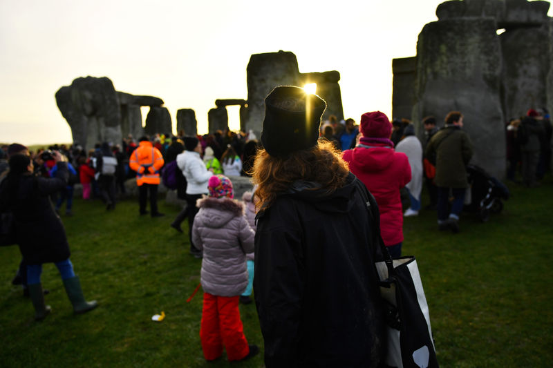 thousands descend on britain s ancient stonehenge for winter solstice