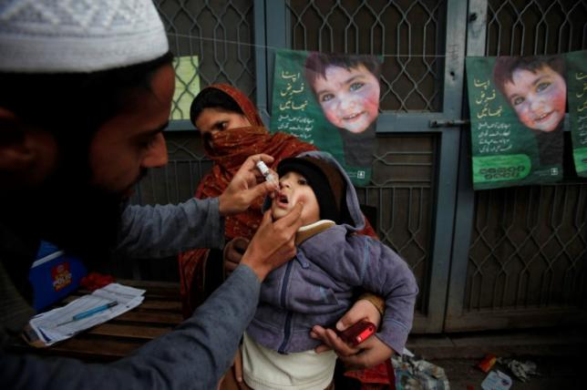 a boy receives polio vaccine drops photo reuters file