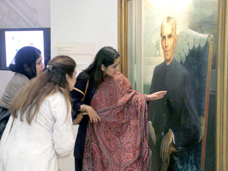 women take a closer look at a portrait of quaid e azam painted by prof saeed akhar at an exhibition at sbp museum on tuesday photo ppi