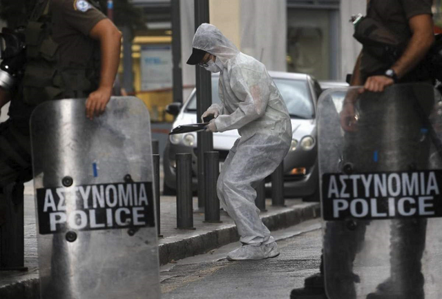 two injured in blast outside athens church