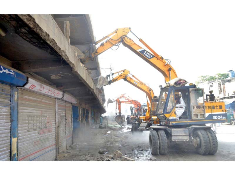 demolition squad 150 shops at karachi zoo razed 250 to go