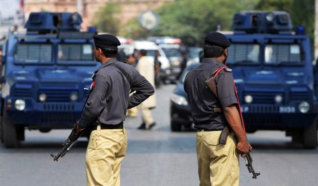 karachi aig sacks four police officials