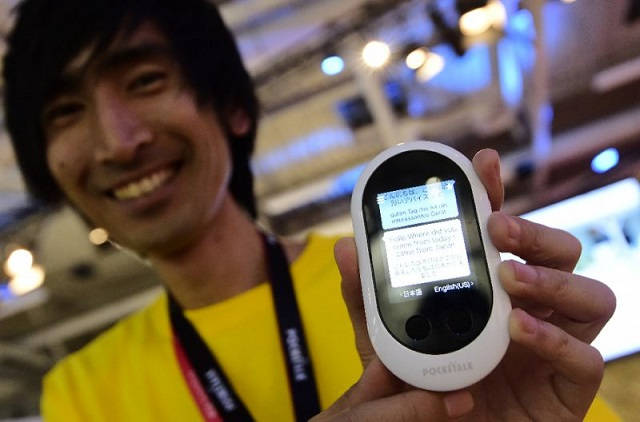 pocketalk which appeared reminiscent of an early generation mobile phone could translate 74 languages and was priced at 299 photo afp
