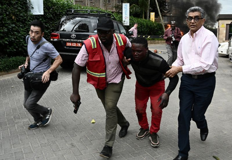an injured man is evacuated from the dusit2 hotel and office complex photo afp