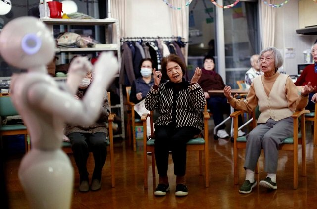 Residents follow moves made by humanoid robot 'Pepper' during an afternoon exercise routine at Shin-tomi nursing home in Tokyo, Japan, February 2, 2018.  PHOTO: REUTERS