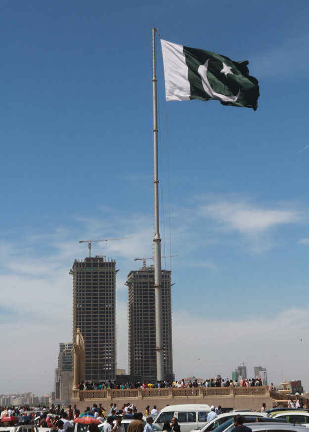 People all over the province hoisted flags to mark Pakistan Day. PHOTO: ATHAR KHAN/EXPRESS