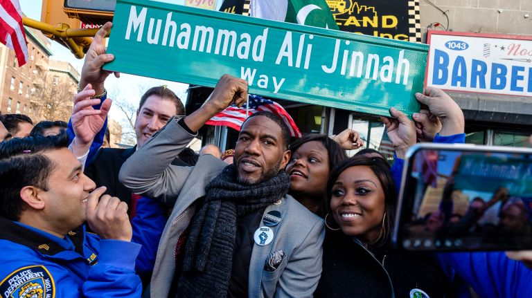 """Councilman Jumaane Williams holds up a replica of the new street sign during a ceremony to rename the """"Little Pakistan"""" stretch of Coney Island Avenue to Muhammad Ali Jinnah Way, on Friday, Feburary 8. PHOTO COURTESY: AMNY.COM"""