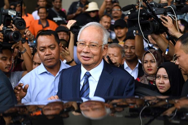 malaysia s toppled leader to go on trial over 1mdb scandal