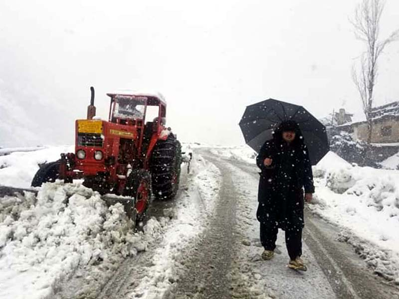 workers clear snow from road near lowari tunnel in chitral during snowfall photo express