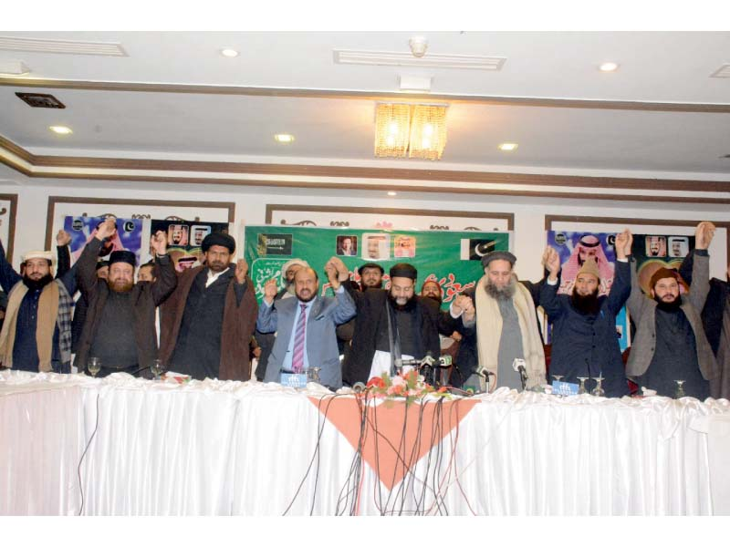 Members of Pakistan Ulema Council express unity during the seminar. PHOTO: EXPRESS
