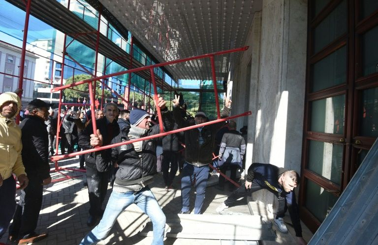police and protesters clash outside albanian parliament