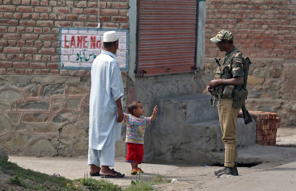 A boy gestures at a member of the occupying security forces in Srinagar. PHOTO: REUTERS