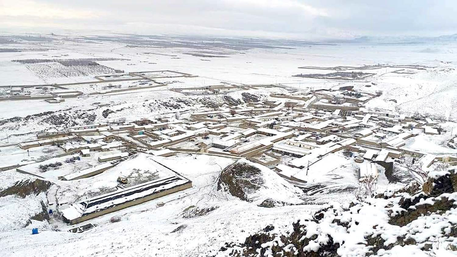 a beautiful snow covered view of khanozai in pishin district photo express
