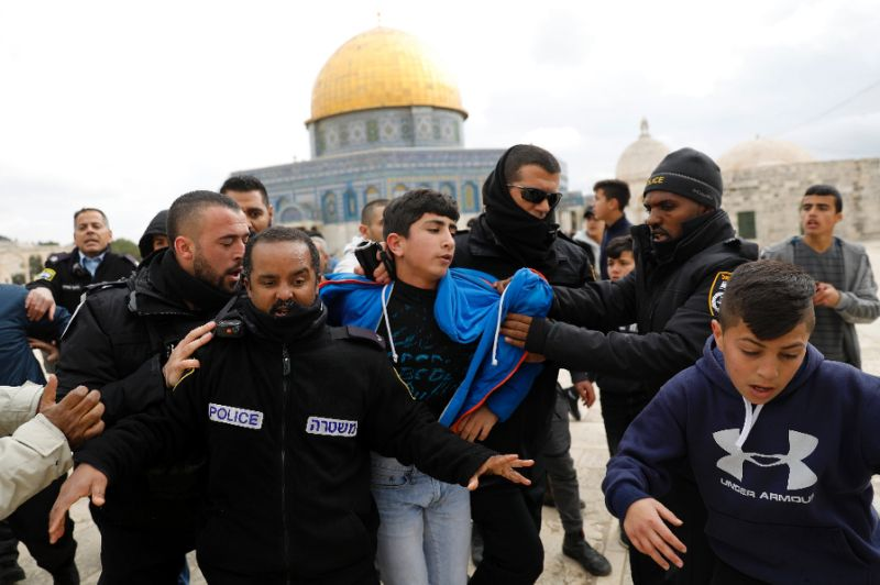 israeli policemen detain a young palestinian demonstrator during clashes after protesters tried to break the lock on a gate at the flashpoint al aqsa mosque compound in jerusalem on february 18 2019 after it was closed by israeli authorities photo reuters