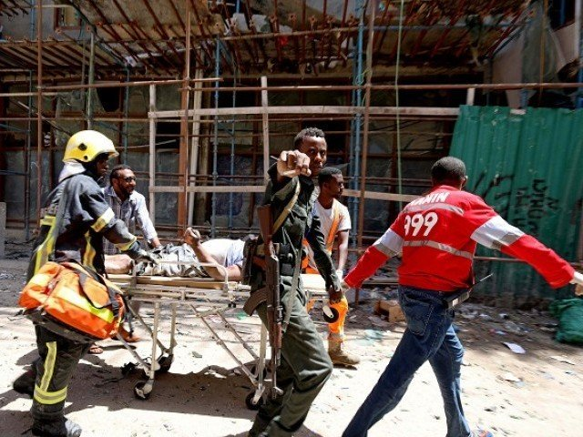 somali security forces and emergency services evacuate an injured man from the scene where a car bomb exploded at a shopping mall in mogadishu somalia february 4 2019 photo reuters