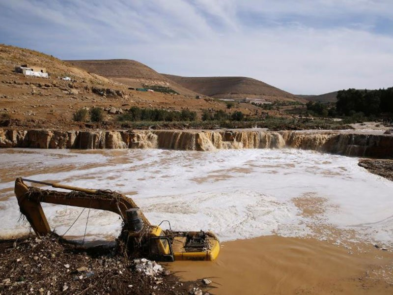an excavator is partially submerged in a stream after rain storms unleashed flash floods in madaba city near amman jordan november 10 2018 photo reuters